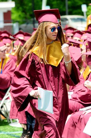 JIM VAIKNORAS/staff photo Newburyport graduate Taylor Szurpicki pumps her fist after getting her diploma at World War Memorial Stadium Sunday morning.