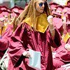 JIM VAIKNORAS/staff photo Newburyport graduate Taylor Szurpicki pumps her fist after getting her diploma at World War Memorial Stadium Sunday morning.