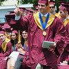 JIM VAIKNORAS/staff photo Newburyport graduate Tharrison Good points to the crowd after getting his diploma at World War Memorial Stadium Sunday morning.