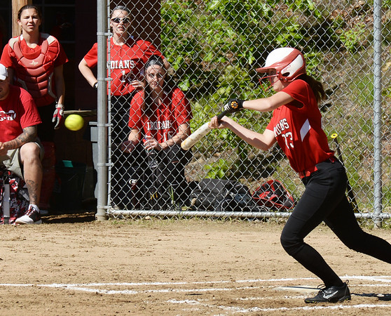 BRYAN EATON/Staff photo. Amesbury's Allison Napoli attempts a bunt.