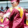 JIM VAIKNORAS/staff photo Twin brothers Brian and Nicholas Toolan , assuming a mix up, exchange diplomas at Newburyport graduation at World War Memorial Stadium Sunday morning.
