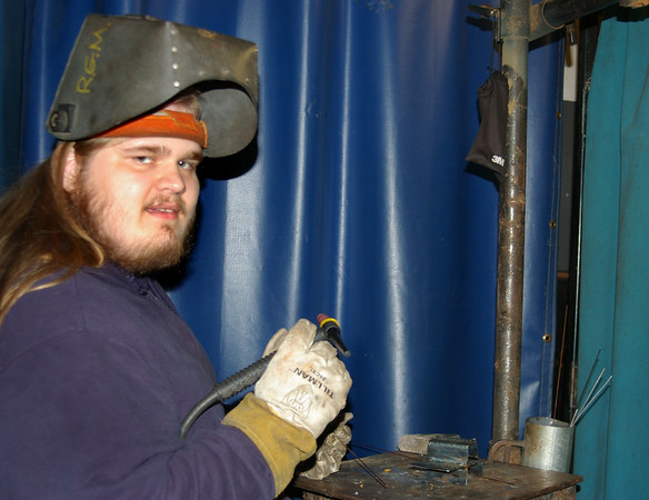 ANGELJEAN CHIARAMIDA/Staff photo. Seabrook's Joe King works on his welding skills at Seacoast School of Technology. The Winnacunnet High School senior graduates tonight with members of the Class of 2017.