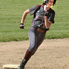 BRYAN EATON/Staff photo. Whittier's Olivia Beauchesne rounds second base on a triple.