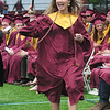 JIM VAIKNORAS/staff photo Newburyport graduate Skyler Ribicandria waves to the crowd after getting her diploma at World War Memorial Stadium Sunday morning.
