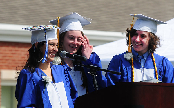 JIM VAIKNORAS/staff photo Class Officers Shealyn McFadden, Samantha Newbury and John Micue, check the mike before leading the Pledge of Allegience at Georgetown's Commencement at Perley School Field Saturday