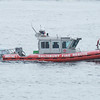 BRYAN EATON/Staff photo. The Salisbury Fire Department's boat was provided coverage in the Merrimack River.