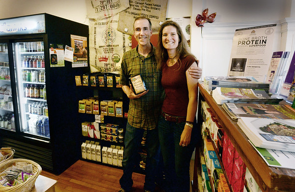 BRYAN EATON/Staff photo. Holding organic coffee, David Termine and Sarah Quinn have opened Health Matters, a health store in downtown Amesbury.