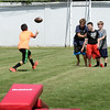 BRYAN EATON/Staff photo. Youngsters around the field throw footballs around.
