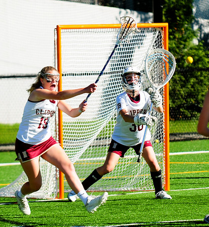 JIM VAIKNORAS/staff photo Newburyport's Jennifer Stuart and goalie Molly Laliberty stop a shot against Austin Prep  at World War Memorial Stadium in Newburyport Wednesday.