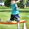 BRYAN EATON/Staff photo. Ben Darsney, 6, hops up as he competes in the hurdle race at Amesbury Elementary School on Thursday. They were having their Field Day.