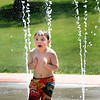 BRYAN EATON/Staff photo. Logan D'Angelo, 4, of Newburyport cools off in the water park at Amesbury Town Park during the heat wave on a visit there with his grandfather Mike Florent. The temperatures get back to normal and drier during the latter half of the week.