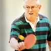BRYAN EATON/Staff photo. Keith Allen of Newburyport returns the ping pong ball in a game of doubles at the Newburyport Senior Center on Tuesday afternoon. The game is played on Tuesdays and Fridays at 1:00 p.m. and has become quite popular.