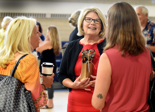 BRYAN EATON/Staff photo. Retiring Immaculate Conception School principal Mary Reardon gets well wishes from parents at the Newburyport School. They held a reception for her last Friday, the last day of school.