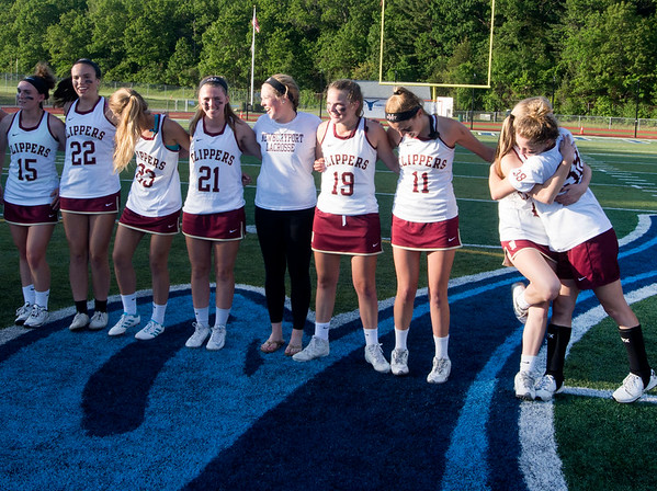 JIM VAIKNORAS/staff photo Newburyport's Molly and Emily Laliberty hug while in line at the trophy ceremony at Peabody High School Friday night. Newburyport defeated Ipswich 15-11 claiming the Div North Championship.