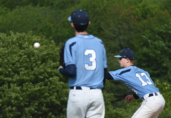 BRYAN EATON/Staff photo. Triton first basemamn Tyler Godfrey is ready for the throw forcing out a Brighton player.