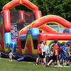 BRYAN EATON/Staff photo. Children go on the inflatable obstacle course at the combine at Landry Stadium.