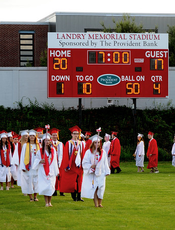 JIM VAIKNORAS/staff photo  Amesbury high seniors make their way into graduation at Landry Stadium in Amesbury Friday night.