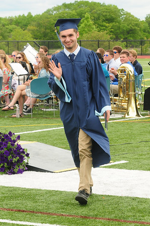 JIM VAIKNORAS/staff photo Triton Graduate Ryan Atherton waves to the crowd his diploma at commencement exercises in Byfield Saturday.