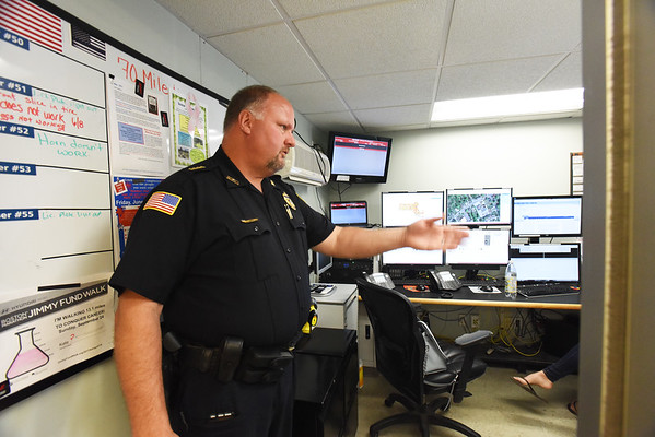 BRYAN EATON/Staff photo. Merrimac police chief Eric Spears shows the dispatch center.