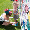 JIM VAIKNORAS/Staff photo Jessica Seguin and her daughter Aubrey , 3, from Amesbury create some art at the Fourth annual Byfield Music and Arts Festival at Manter Field in Byfield Saturday.