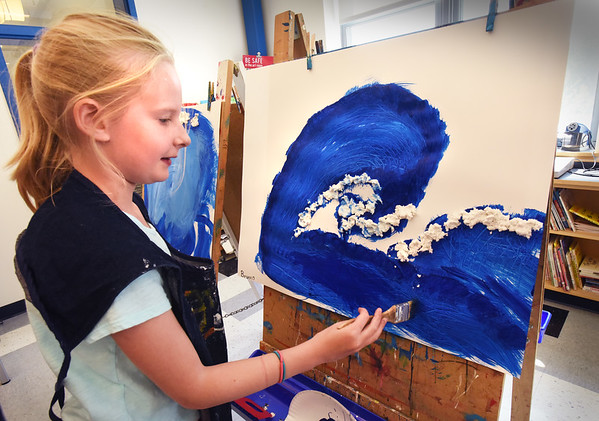 "BRYAN EATON/Staff photo. With the Beach Boys' ""Catch a Wave"" playing in the background, Brynn Ponting, 9, paints one in the style of 18th-century Japanese artist Hokusai in Pam Jamison's art class at the Bresnahan School on Tuesday. The sub-theme of the artwork the teacher joked, ""we'll be waving goodbye"" as summer break starts next week."