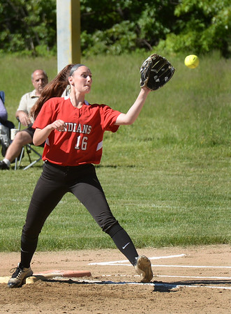 BRYAN EATON/Staff photo. Amesbury first baseman Mikayla Porcaro makes the catching forcing out a Whittier player.