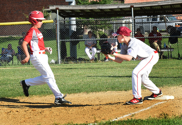 BRYAN EATON/Staff photo. Amesbury's Connor Ishihara is forced out a third base.