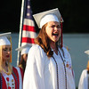 JIM VAIKNORAS/staff photo  Senior Alexa Schlicher performs an inspired rendition of the National Anthem at Amesbury's graduation at Landry Stadium in Amesbury Friday night.