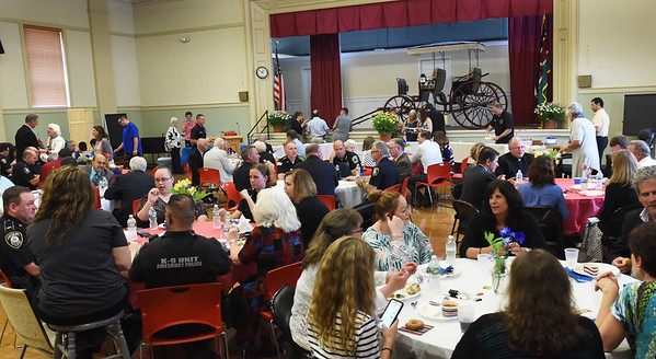 BRYAN EATON/Staff photo. A large crowd turned out at a lunch to honor retiring Amesbury police chief Kevin Ouellet who has been with the force for 37 years.