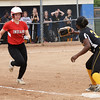 BRYAN EATON/Staff photo. Boston Latin's first baseman has the ball forcing Amesbury's Hayley Catania out.