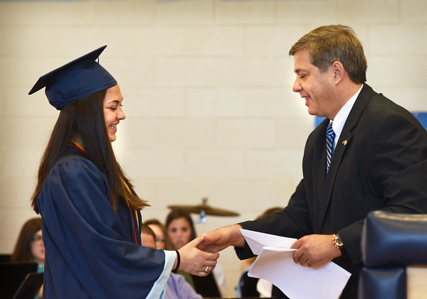 BRYAN EATON/Staff photo. Sen. Bruce Tarr presents the Alan J. White Scholarship to a graduating Triton High School senior Cassandra McGrath at an awards ceremony of Friday.
