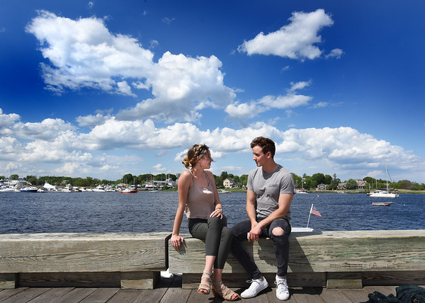 BRYAN EATON/Staff photo. Sydne Campbell of Portland, Maine, left, and Josh Voto of Tewksbury enjoy the Newburyport waterfront on Thursday afternoon. The weather for the weekend is looking good, though there could be a shower.