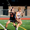JIM VAIKNORAS/staff photo Newburyport's Molly Rose Kearney makes a move on Ipswich's Isabel Primack during their game at Peabody High School Friday night. Newburyport won 15-11 claiming the Division 2 North Championship.