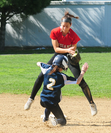 JIM VAIKNORAS/staff photo  Amesbury's Maddie Napoli tries to get the tag down as Winthrop's Nicole Newman steals second  at Amesbury Friday.