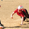 JIM VAIKNORAS/staff photo  Amesbury's Mikayla Porcaro dives back to first against Winthrop at Amesbury Friday.