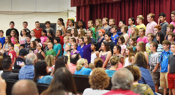 "BRYAN EATON/Staff photo. Fourth-graders sing ""You're Beautiful,"" one of several songs they sang for their Celebration Assembly in front of parents on Tuesday morning. Their last day of school is Thursday and they will be heading to Amesbury Middle School in the fall."