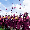 JIM VAIKNORAS/staff photo Newburyport graduates toss their cap after gettng their diplomas at World War Memorial Stadium Sunday morning.