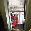 BRYAN EATON/Staff photo. The second egress from the upstairs office space opens to a landing in the fire department garage where a ladder is attached to the wall for emergency exit.