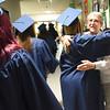 BRYAN EATON/Staff photo. A Triton High School senior hugs Brenda Davis who retired from Salisbury Elementary School 13 years ago but still volunteers and tutors there.
