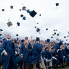 JIM VAIKNORAS/staff photo Triton graduates toss their caps in celebration at the commencement exercises in Byfield Saturday.