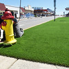 BRYAN EATON/Staff photo. Tom Moulton of TM Turfscapes in Hamilton installs turf at Salisbury Beach on Broadway on Wednesday. The green turf is just one of the ongoing improvements to the beach center.