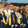 JIM VAIKNORAS/staff photo Triton graduating seniors sing the National Anthem at commencement exercises in Byfield Saturday.