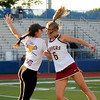 JIM VAIKNORAS/staff photo Newburyport's Isabelle Sarra and #6 , Molly Rose Kearney give each other a flying shoulder bump at Peabody High School Friday night. Newburyport defeated Ipswich 15-11 claiming the Div North Championship.