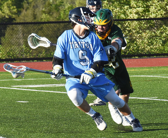 BRYAN EATON/Staff photo. Triton's John D'eufemia gets pressure from a North Reading player.