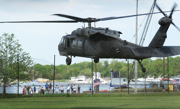 BRYAN EATON/Staff photo. A Blackhawk helicopter touches down on the ball field at Cashman Park in Newburyport before the start of the Derek Hines 5K Roadrace.