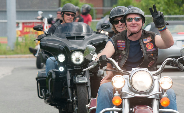 JIM VAIKNORAS/Staff photo Brian and Gale Brunault head down Graf Road in Newburyport Saturday morning in the 3rd annual Michael's Ride to raise money for the Michael Colby Art Scholarship Fund. Over 100 riders participated in the event.