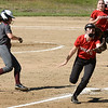 BRYAN EATON/Staff photo. Amesbury third baseman Ashlee Porcaro goes for an over throw as Whittier's Alyssa Alestock heads to home plate.