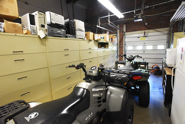 BRYAN EATON/Staff photo. The two-bay garage houses two off-road vehicles, but is mostly used for storage.