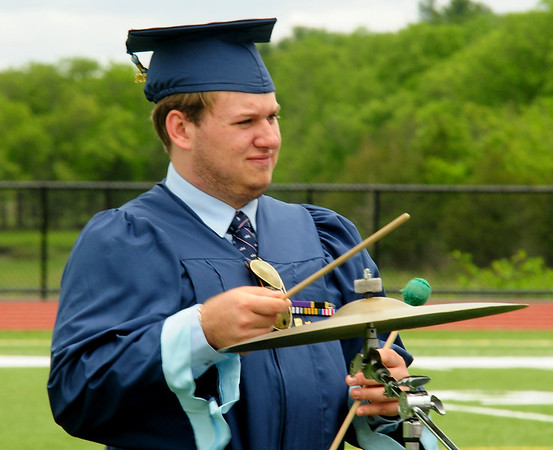 JIM VAIKNORAS/staff photo Triton graduating senior Andrew Pesaturo perform with the band at commencement exercises in Byfield Saturday.