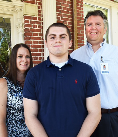 BRYAN EATON/Staff photo. Kyle Carter, flanked by his parents Tanya and Erik, all work at the Anna Jaques Hospital.